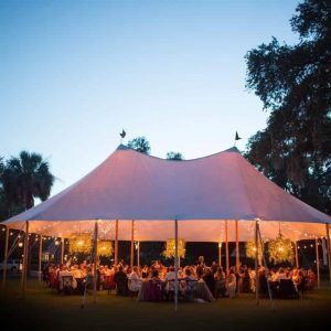 Wedding tent over the River House Lawn at Sunset